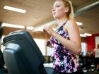 Fit Woman Running On Treadmill In Gym